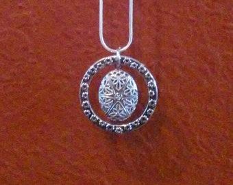 Floating silver filigree diffuser pendant necklace