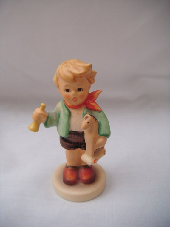 Hummel Figurine Boy with Horn and Toy Horse