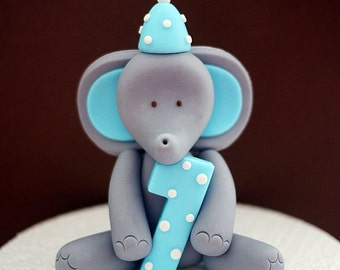 Elephant fondant cake topper. Elephant cake topper with number and party hat for birthday