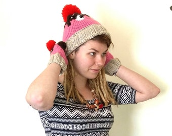 Cupcake hat. Hand knitted cupcake bobble hat with pom pom cherry and sprinkles