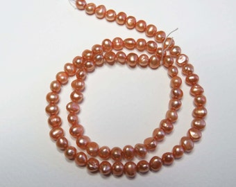 """Orange Freshwater Pearls. 15.5"""" Strand. Size approx 5-6mm"""