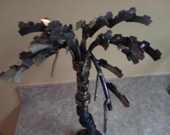 industrial metal sculpture palm tree