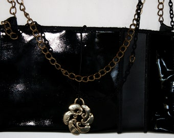 Black patent leather clutch bag