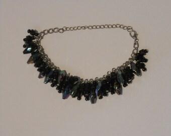 Very unique iridescent black chunky beaded bracelet.