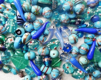 ONE Pound. New handmade lampwork  glass charms chillies//fishes in blue color combination  Approx 8 mm -  40 mm
