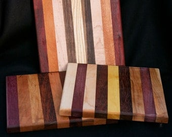 """8x8.5"""" cutting board/butcher block made from different woods from around the world.  i will pick one out and send it to you"""
