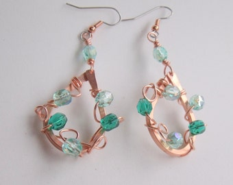 jewelry earrings copper earrings that are hand forged with aqua and green Czech crystals
