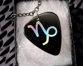 Capricorn sign guitar pick necklace, black & silver, hot foil stamped