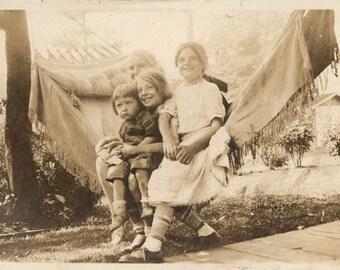 vintage photo snapshot 1920 Girls Cuddle in to a Hammock Big Smiles Happy Children