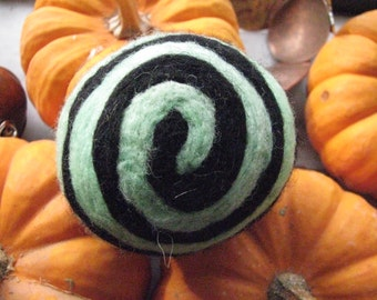 One multi-colored felted pin-cushion, Mint Green and Black