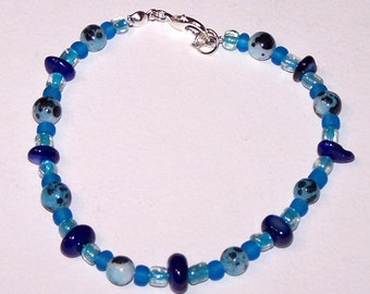 delicate blue glass and shell bracelet