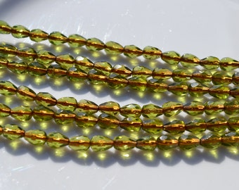 Olivine with copper Lined Faceted Long Drilled Teardrop Beads  25