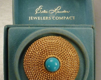 ESTEE LAUDER COMPACT Jeweler's compact goldtone with Blue glass stone mint in box Honey Glow Collectible