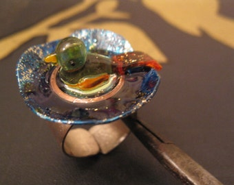 adjustable pond ring with glass bird
