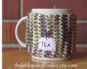 Knitted tea mug cozy cup cozy in spring blossoms with hanging tea patch