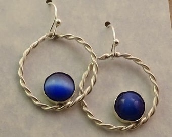 Twisted circle silver earrings with blue cabs on sterling ear wires