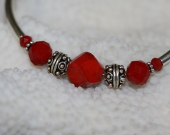 Ruby red color beads  and sterling silver bracelet