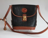 Vintage Dooney and Bourke AWL Black Tan Pebbled Leather Structured Purse British Cross Body With Clasp