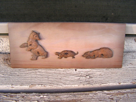 Items similar to canadian wood carving animals relief