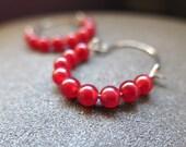 red stone earrings. silver niobium hoop. hypoallergenic jewelry.