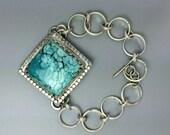 Turquoise metalwork chain bracelet