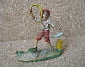 Vintage  plastic Fisherman Boy with fish figurine marked Italy