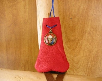 "Skull, red leather drawstring pouch with red, white and blue skull glass charm, 3.5"" x 2.5"" adjustable 36"" blue nylon neck cord"