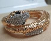 vintage costume jewelry  /  gold tone rhinestone snake coil bracelet