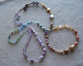 Aqua/lavender/purple/amber tones/warm rusts/long strand necklace/flower beads/freshwater pearls/ 1/4 turn/multi colors/goes with everything!