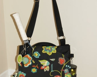 Large Tennis Bag with rounded pockets made of water repellent  fabric.