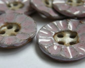 Textured pink ceramic buttons