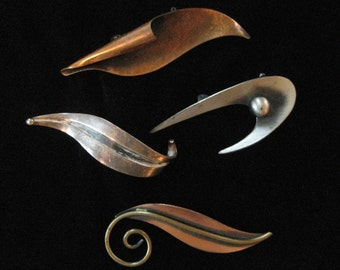 LOT: 4 Mid Century Swoosh Brooches, One Maricela Taxco Sterling
