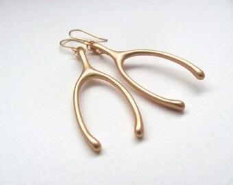 Oversized golden wishbone pendant earrings, matte gold finish 16k gold plate