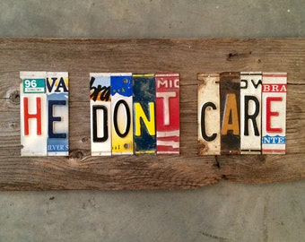 HE DONT CARE upcycled recycled license plate art sign tomboyART tomboy Ooak Rl Burnside