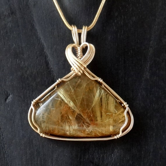Rutilated quartz pendant in gold filled wire for Golden rutilated quartz jewelry
