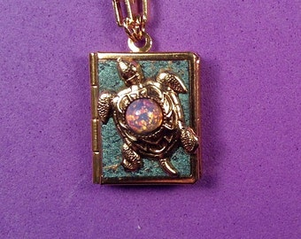 Sea Turtle Peace Book, turquoise and gold, with words for peace from around the world