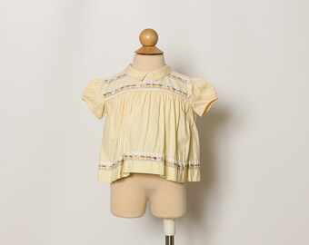 vintage 1960s baby girl's yellow train top blouse