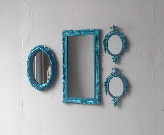 Decorative mirror set in shimmering aqua by for Teal framed mirror