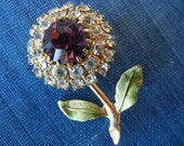 Vintage Flower Brooch with large purple glass center rhinestone design floral pin back perfect for a denim jacket