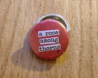 A Rose Among Thorns - Pinback Button, Magnet, Mirror, or Bottle Opener