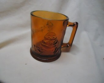 "Vintage Amber ""Humpty Dumpty & Tom Tom the Piper's Son Glass Mug, collectable. brown"