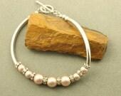 Sterling Silver Curved Tube Bracelet with Swarovski Pearls