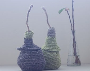 The Pod Family Baskets in dark brown and apple green - set of two small baskets