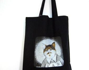 Black canvas bag with a tri color orange cat print.
