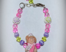 Custom Boutique toddlers girls Polymer Clay Bracelet OOAK Pink White Green Purple Spring Heart Love Brown Hair Girl  Flowers