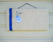 French chic designed pinboard made from white burlap with a ruffled satin ribbon accent in royal blue, photo display, memo board