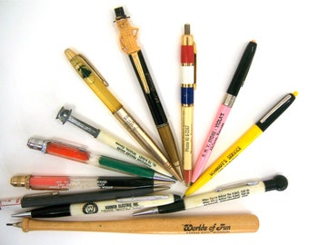 Advertising pens and pencils vintage collectibles for assemblage multimedia art, Mr Peanut, baseball bat, Phillips 66, Southwestern Bell