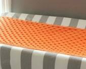 Gray & white stripe with accent orange minky Contour Changing pad cover.