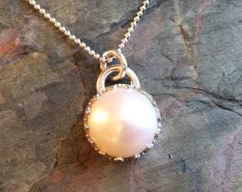 White Pearl set on a Sterling Silver Crown Setting with a Sterling silver 16 inch Rolo Chain