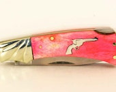 Rough Rider Pink Bone pocket knife with sterling silver pistol inlay